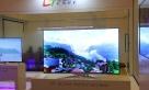 """华星光电展出了全球领先的显示产品65""""8K超薄曲面电视"""